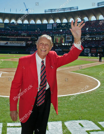 """MUSIAL Hall of Famer Stan""""The Man"""" Musial waives to the fans after throwing out the first pitch before game one of the National League Division Series between the Los Angeles Dodgers and the St. Louis Cardinals in St. Louis"""