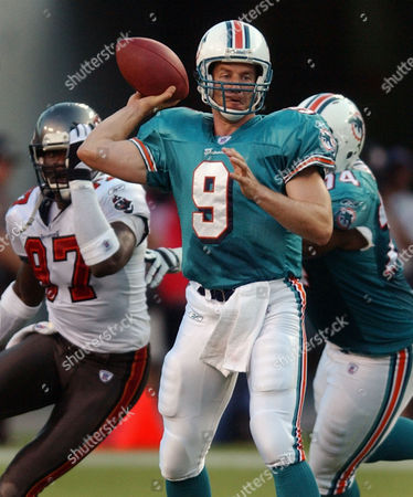 FIEDLER SMITH RICE Miami Dolphins quarterback Jay Fiedler (9) throws from the pocket as Dolphins' tackle Wade Smith (74) pushes Tampa Bay Buccaneers' Simeon Rice (97) out of the way during the first quarter of their pre-season game Saturday night, in Tampa, Fla