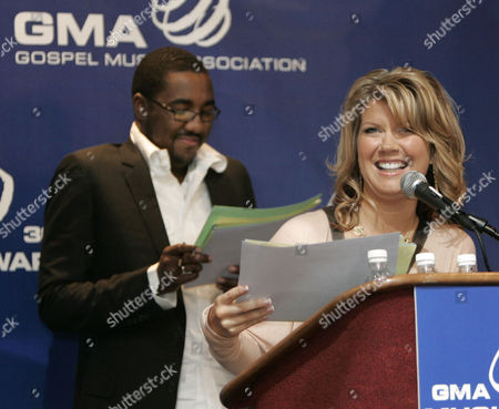 Stock Picture of HUFF Gospel singer Natalie Grant laughs after getting stuck on the pronounciation of a name as she reads a list of nominees for the annual Gospel Music Association Dove awards, in Nashville, Tenn. Singer George Huff, waiting for his turn to read, is at left