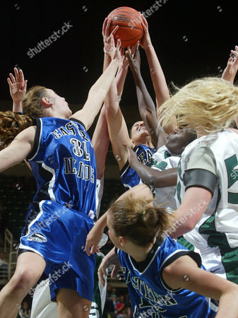 LUCAS-PERRY Eastern Illinois' Meagan Scaggs, left, Janelle Cazy, center top, Sarah Rivah, bottom, and Michigan State's Laura Hall, far right, and Victoria Lucas-Perry fight for a rebound in the first half, in East Lansing, Mich