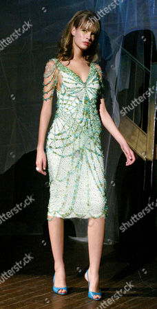 A model wears a sea green and blue multi-strand beaded coctail dress at the Bradley Bayou for Halston Spring 2005 collection, in New York