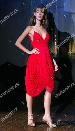 A model wears a fuchsia hand draped silk chiffon cocktail dress at the Bradley Bayou for Halston Spring 2005 collection, in New York