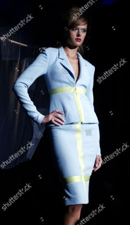 A model wears a cielo blue wool crepe suit with lime satin inserts at the Bradley Bayou for Halston Spring 2005 collection, in New York