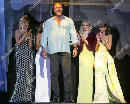 Designer Bradley Bayou greets the audience at the conclusion of his spring 2005 collection for Halston in New York