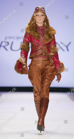 """A fuchsia cracked patent leather aviator jacket with chinchilla trim and rust leather jodhpurs are modeled from the collection of Kara Saun during the """"Project Runway"""" reality TV fashion show on the first day of Fashion Week in New York, . The Bravo televison show's designer finalists presented their full line of fall/winter 2005 fashions at the show"""