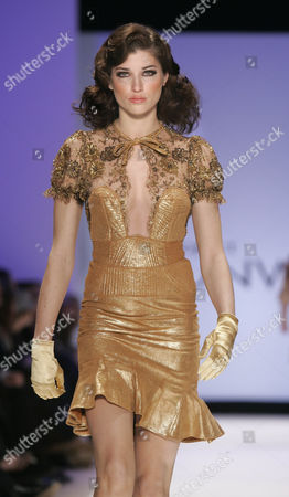 """A beaded lace and gold metallic leather quilted dress is modeled from the collection of Kara Saun during the """"Project Runway"""" reality TV fashion show on the first day of Fashion Week in New York, . The Bravo televison show's designer finalists presented their full line of fall/winter 2005 fashions at the show"""