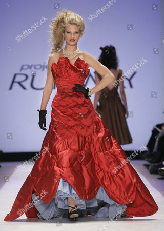"""A hand quilted scarlet satin evening dress is modeled from the collection of Austin Scarlett during the """"Project Runway"""" reality TV fashion show on the first day of Fashion Week in New York, . The Bravo televison show's designer finalists presented their full line of fall/winter 2005 fashions at the show"""