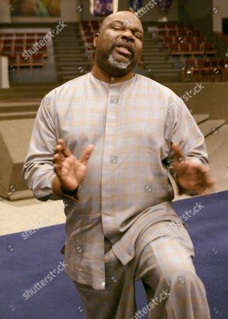 """JAKES Bishop T.D. Jakes stands in his church's empty 8,000-seat sanctuary and talks about his new movie, """"Woman, Thou Art Loosed."""", in Dallas"""