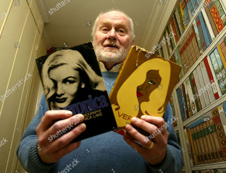 Donald Bain holds two versions of the cover of his biography on actress Veronica Lake at his home in North Salem, New York