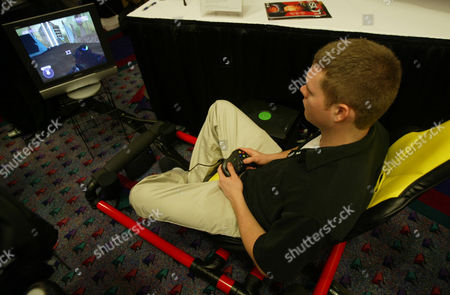 HOT SEAT Justin Campbell demostrates the Hot Seat Tues, at the Consumer Electronics Show in Las Vegas. The gaming chassis features surround sound and vibration for an arcade-like experience in the home