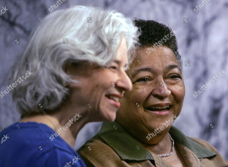 Stock Image of REIS STEELE Partners Beth Reis, left, and Barbara Steele smile as they chat in the hallway during a break in a court hearing for same-sex couples who want the right to marry, in Seattle. Eight gay or lesbian couples are suing to overturn a state defense of marriage law prohibiting gay marriage. Their lawsuit was filed in March