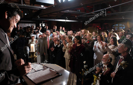 DURAN Couples applaud as West Hollywood Mayor John Duran, left, introduces guests during the symbolic mass gay wedding celebration at the Abbey in the West Hollywood, Calif