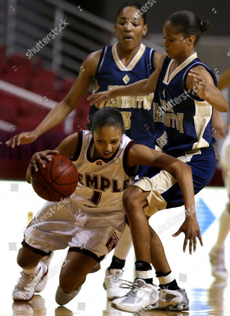 Stock Image of JORDAN Temple's Cynthia Jordan has trouble controlling the ball as she tries to get around Whitney Allen,left, and Kimberly Beck,right, of George Washington in the first half in Philadelphia