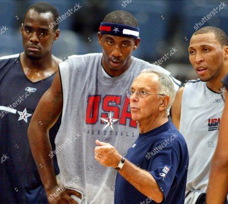 Brown Okafor Stoudemire Marion U.S. basketball players, from left, Emeka Okafor of the Charlotte Bobcats, and Phoenix Suns players Amare Stoudemire and Shawn Marion, listen to head coach Larry Brown, front, during a U.S. basketball team practice in Cologne, western Germany, . The U.S. team is preparing for upcoming matches against Italy and Germany and for the Olympics in Athens