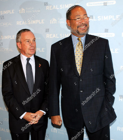 """New York City Mayor Michael Bloomberg, left, and Dick Parsons, chairman and CEO of Time Warner pose for photos at the """"Get Organized New York"""" tag sale to benefit the Fund for Public Schools at Jazz at Lincoln Center, in New York"""