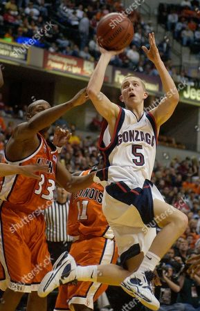 Stock Picture of RAIVIO MCBRIDE Gonzaga guard Derek Raivio (5) is fouled by Illinois forward Rich McBride (33) during the first half in a Wooden Tradition game in Indianapolis