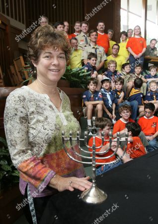 ZOMPER Cub Scout mother Dianne Zomper poses for a photo with a menorah and members of Congregation Emanu El's Pack 1190, who sent care packages to Jewish soldiers serving overseas, in Houston. Zomper's son, Mitchell, along with other cub scouts prepared packages with Hanukkah candles, menorahs and dreidels to send to solders in Iraq, Afghanistan, and Kuwait