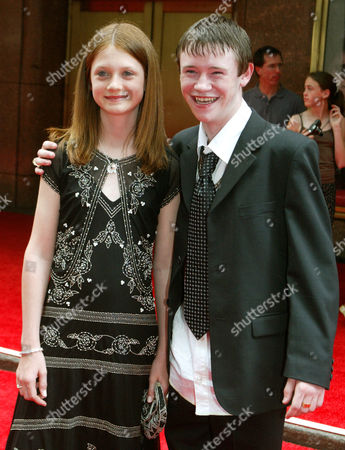 "Bonnie Wright, left, and Devon Murray walk the red carpet during the New York premiere of ""Harry Potter and the Prisoner of Azkaban"