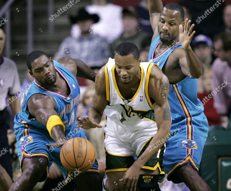 LEWIS ROGERS LYNCH Seattle SuperSonics' Rashard Lewis, center, tries to keep the ball from New Orleans Hornets' Rodney Rogers, left, and George Lynch in the first half, in Seattle