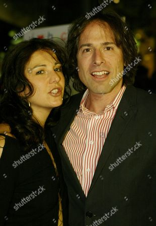 """RUSSELL Director David O. Russell, right, and his wife Janet Grillo arrive at the premiere of his new movie """"I Heart Huckabees"""" outside The Grove movie theater in Los Angeles"""