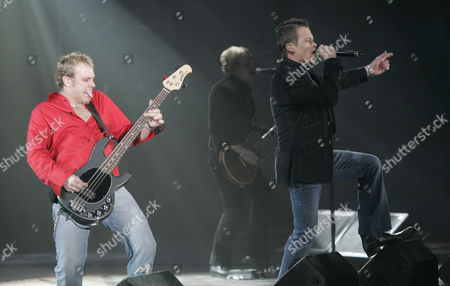 """Stock Image of DOORS DOWN Bassist Todd Harrell, left, and lead singer Brad Arnold of the rock group 3 Doors Down performs at the D.C. Armory in Washington, D.C. during a pre-inaugural concert billed as """"America's Future Rocks Today"""