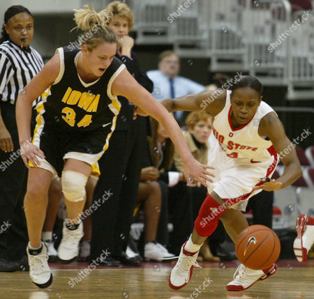 Stock Picture of SOLVERSON ALLEN *{A9FDBDC8-8773-4CF8-A1D8-62901C59B310 Iowa's Johanna Solverson (34) and Ohio State's Ashley Allen (right) scramble for a loose ball during the first half of their game in Columbus, Ohio