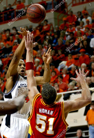 GRAHAM HOMAN Oklahoma State guard Joey Graham, left, shoots over Iowa State center Jared Homan, right, in the second half of game, in Stillwater, Okla., . Joey Graham had 20 points in the Oklahoma State 83-73 victory