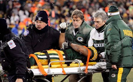 Green Bay Packers receiver Robert Ferguson gives a thumbs up as he is taken off the field on a stretcher after being hit by Jacksonville Jaguars safety Donovin Darius (20) in the fourth quarter, in Green Bay, Wis. Darius was ejected from the game after the hit. Ferguson was taken to a local hospital. The Jaguars won 28-25