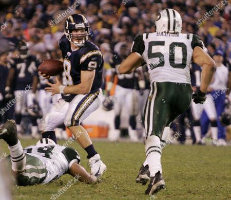 BREES BARTON HOBSON San Diego Chargers Drew Brees (9) looks for an open receiver late in the fourth quarter against the New York Jets in the AFC wild-card game in San Diego . After Brees released the incomplete pass, Jets Eric Barton (50) hit Brees forcing a roughing the passer call against the Jets. The Chargers capitalized on the call to score the final regulation touchdown setting-up the game-tying extra point. Also in on the play was Jets Victor Hobson (left). The Jets won 20-17 in overtime