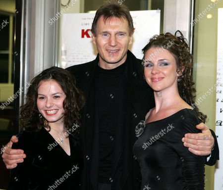 """Stock Image of Actor Liam Neeson poses for a photograph with Jenna Gavigan, left, and Leigh Spofford, right before the premiere of the movie """"Kinsey"""" at the Beekman Theater in New York"""