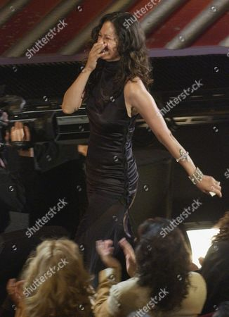 "ROSA Angela Alvarado Rosa reacts as she approaches the stage after winning the award for Best Music Video for the work she and her husband, Robi Draco Rosa, performed on ""Mas y Mas"" at the 5th annual Latin Grammy Awards in Los Angeles"