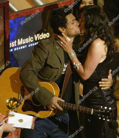 "ROSA Robi Draco Rosa kisses his wife, Angela Alvarado Rosa, after the two won Best Music Video for their work on ""Mas y Mas"" at the 5th annual Latin Grammy Awards in Los Angeles . Robi performed on the video which was directed by Angela"