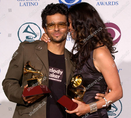 ROSA Robi Draco Rosa, left, and wife Angela Alvarado Rosa pose with thier award for Best Music Video, at the 5th Annual Latin Grammy Awards in Los Angeles