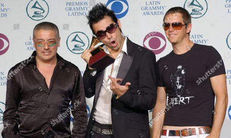 LA LEY Music group La Ley pose with thier award for Best Rock Album by a Duo or Group with Vocal, at the 5th Annual Latin Grammy Awards in Los Angeles, . From left are Mauricio Claveria, Pedro Frujone and Beto Cuevas
