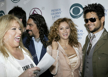 Ednita Nazario, from left, Diego El Cigala, Paulima Rubio, and Robi Rosa are seen during nominations for the 5th annual Latin Grammy awards in Los Angeles. The awards are set for Sept. 1, 2004, at the Shrine Auditorium in Los Angeles during a live broadcast on CBS