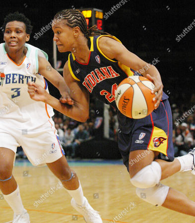 Indiana Fever's Tamika Catchings drives past New York Lilberty's Crystal Robinson during the second half at New York's Madison Square Garden, . Catchings was the Fever's high scorer with 17 points in their 72-68 win over the Liberty