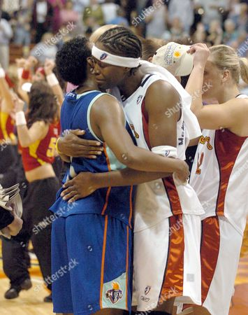 Stock Photo of ROBINSON MCWILLIAMS-FRANKLIN The Connecticut Sun's Taj McWilliams-Franklin, right, gives the New York Liberty's Crystal Robinson a hug after the Sun defeated the Liberty 60-57 to win the WNBA Eastern Conference Finals in Uncasville, Conn