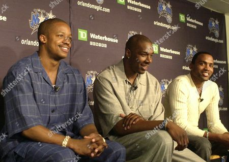 FRANCIS CAO MOBLEY New Orlando Magic players, from left, Steve Francis, Kelvin Cato, and Cuttino Mobley field a questions during a news conference at the Magic training facility in Orlando, Fla., . The trio were obtained from the Houston Rockets in a trade that sent Tracy McGrady, Tyronn Lue, Reece Gaines, and Juwan Howard to the Rockets