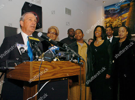New York Mayor Michael Bloomberg speaks at the Audubon Ballroom, scene of the 40th anniversary of the assassination of Malcolm X, Monday, Feb.21, 2005, New York. To the right of Bloomberg are three daughters of Malcolm X: Gamilah Shabazz, left, Ilyasah Shabazz, second from right, and Malaak Shabazz, far right. To the right of Gamilah is her son Malek. Others are unidentified