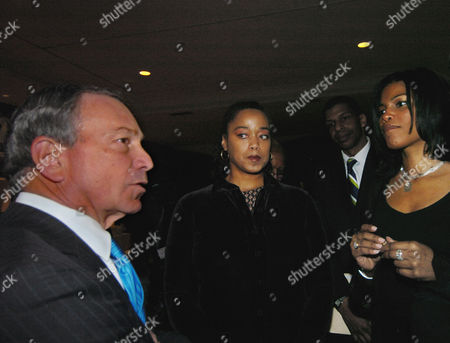 BLOOMBERG SHABAZZ New York Mayor Michael Bloomberg speaks with Malaak, left, and Ilyasah Shabazz, right, during a tribute to their father Malcolm X at the Audubon Ballroom, the scene of the 40th anniversary of his assassination, Monday, Feb.21, 2005, New York