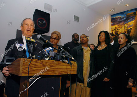 New York Mayor Michael Bloomberg speaks at the Audubon Ballroom, scene of the 40th anniversary of the assassination of Malcolm X, Monday, Feb.21, 2005, New York. To the right of Bloomberg are three daughters of Malcolm X: Gamilah Shabazz, left, Ilyasah Shabazz, second from right, and Malaak Shabazz, far right. To the right of Gamilah is her son Malek. Others are unidentified. (AP Photo/ Louis Lanzano