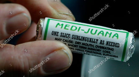 """In this picture, cancer patient Christopher Campbell holds roll of """"MEDI-JUANA"""" in Portland, Ore"""