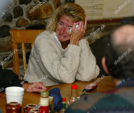 BARGETTO Rita Bargetto reacts during a prayer for family members missing in a snow storm, in Shaver Lake, Calif. Four members of Bargetto's Santa Cruz County wine-making family have been missing since Sunday at a 9,400-foot-elevation lake east of Fresno in the Sierra National Forest