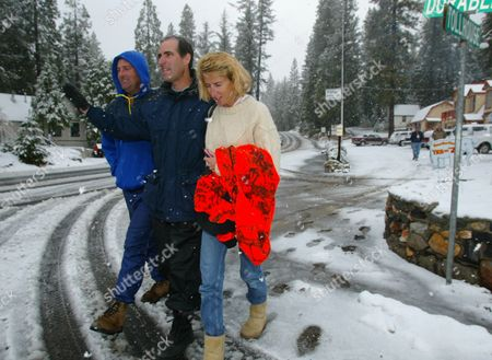 BARGETTO Peter, John, center, and Rita Bargetto, right, take a walk after a prayer session for family members missing in a snow storm, in Shaver Lake, Calif. Four members of the Bargetto's Santa Cruz County wine-making family have been missing since Sunday at a 9,400-foot-elevation lake east of Fresno in the Sierra National Forest