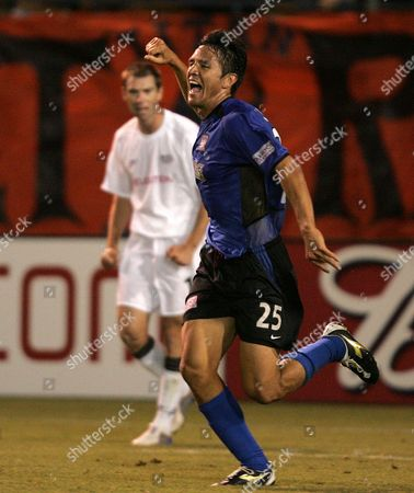 CHING RALSTON San Jose Earthquakes' Brian Ching, front, celebrates after scoring to tie the New England Revolution 2-2 in stoppage time at Spartan Stadium in San Jose, Calif., . New England's John Ralston is at rear