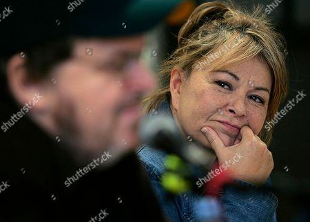 MOORE BARR Actress Rosanne Barr listens to filmmaker Michael Moore during a news conference before his appearance on the Utah Valley State College campus, in Orem, Utah. Barr, who was born and raised in Salt Lake City, made a special guest appearance on stage