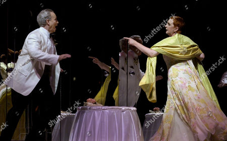 """Stock Picture of GARDNER FLANIGAN Jake Gardner, as Jules Mackenzie Goddard, the husband of Antonia, chases after Lauren Flanigan, as Catherine """"Tulip"""" Brenner, mother of the bride, in William Bolcom's operatic version of the Robert Altman's 1978 film """"A Wedding"""" during dress rehearsal, at the Lyric Opera in Chicago. The opera will have its world premiere on Saturday, Dec. 11"""