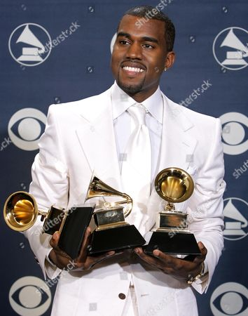 "WEST Kanye West poses with his three awards at the 47th Annual Grammy Awards in Los Angeles. West is the hip-hop act with the most Grammy Awards, with 14 wins. He's nominated for seven Grammys this year, including song of the year for ""All of the Lights"