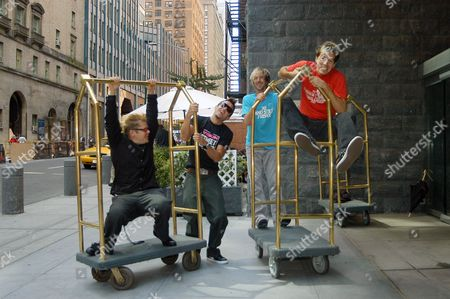 Music group Hoobastank have some fun outside the Le Parker Meridien hotel in New York, . From left, are Markku Lappalainen, Doug Robb, Chris Hesse and Dan Estrin