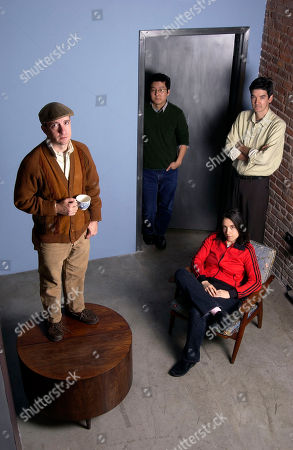 Music group Magnetic Fields pose at Sacks and Co. in New York on . From left are Stephin Merritt, John Woo, Claudia Gonson, sitting, and Sam Davol